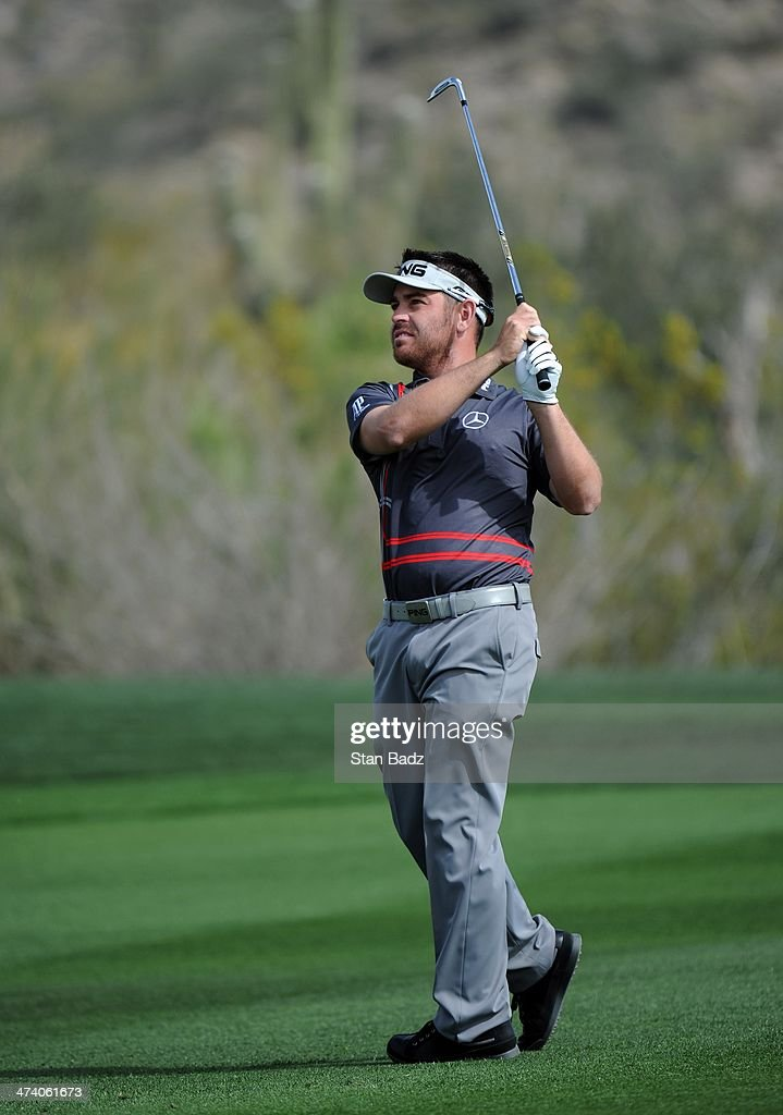 Louis Oosthuizen of South Africa hits a shot on the first hole during the third round of the World Golf Championships-Accenture Match Play Championship at The Golf Club at Dove Mountain on February 21, 2014 in Marana, Arizona.