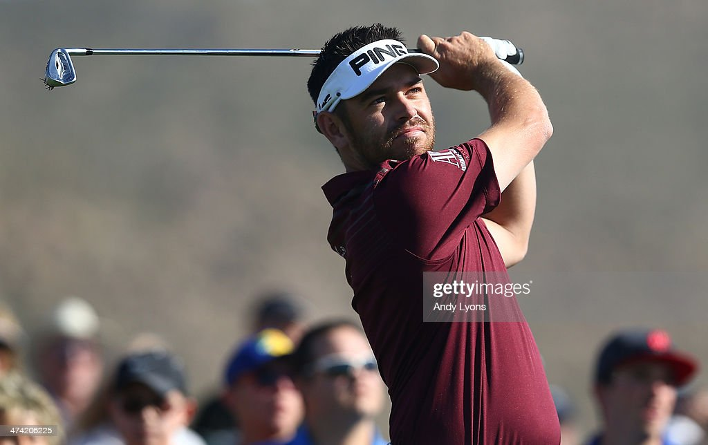 Louis Oosthuizen of South Africa hits a tee shot on the third hole during the quarterfinal of the World Golf Championships - Accenture Match Play Championship at The Golf Club at Dove Mountain on February 22, 2014 in Marana, Arizona.