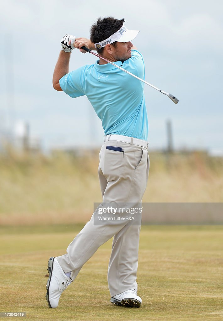 Louis Oosthuizen of South Africa hits an approach shot ahead of the 142nd Open Championship at Muirfield on July 16, 2013 in Gullane, Scotland.