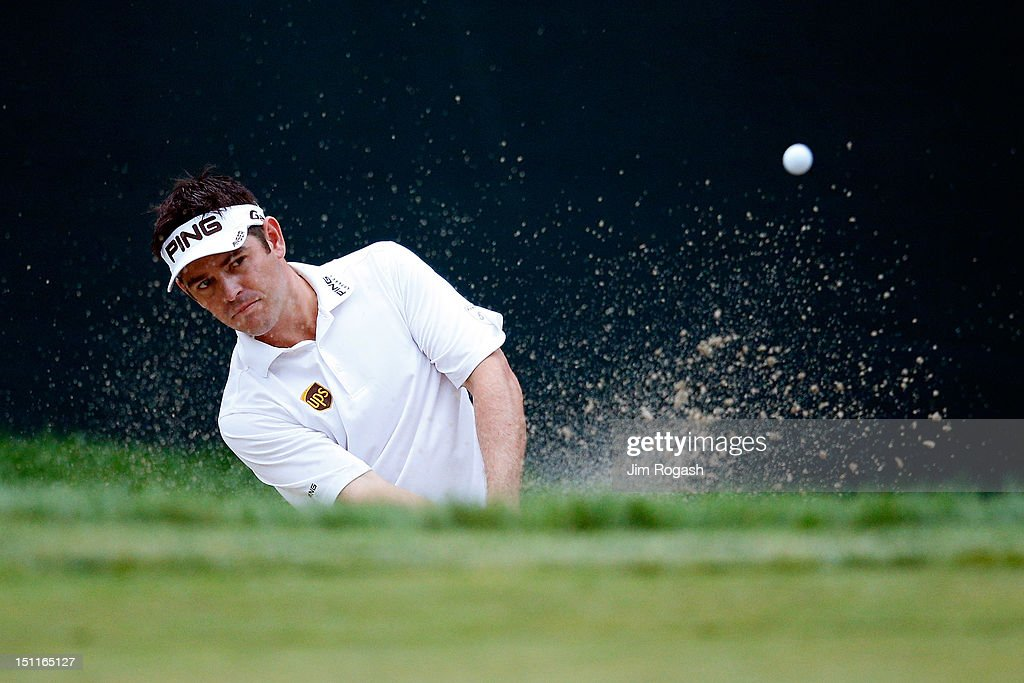 <a gi-track='captionPersonalityLinkClicked' href=/galleries/search?phrase=Louis+Oosthuizen&family=editorial&specificpeople=241573 ng-click='$event.stopPropagation()'>Louis Oosthuizen</a> of South Africa hits an approach shot from the 17th hole during the third round of the Deutsche Bank Championship at TPC Boston on September 2, 2012 in Norton, Massachusetts.