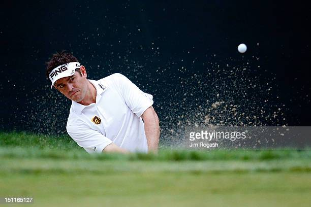 Louis Oosthuizen of South Africa hits an approach shot from the 17th hole during the third round of the Deutsche Bank Championship at TPC Boston on...