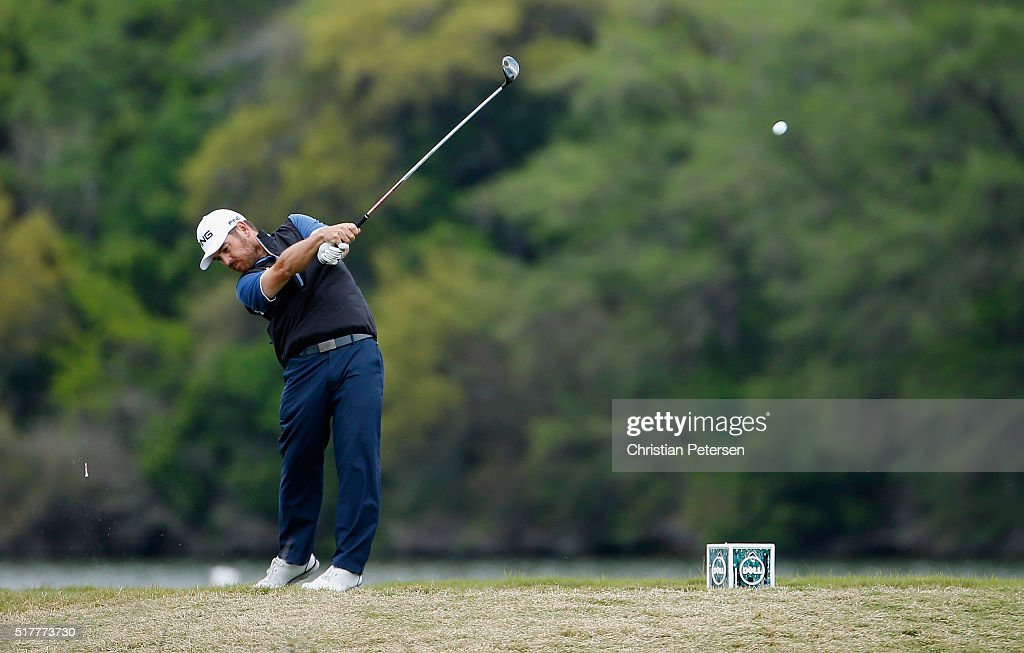 Louis Oosthuizen of South Africa hits his tee shot on the 14th hole during his semifinal match with Rafa CabreraBello at the World Golf...