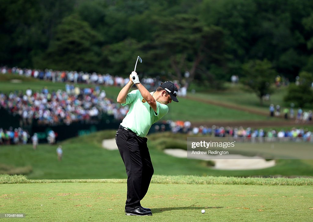 Louis Oosthuizen of South Africa hits his tee shot on the ninth hole during Round One of the 113th U.S. Open at Merion Golf Club on June 13, 2013 in Ardmore, Pennsylvania.
