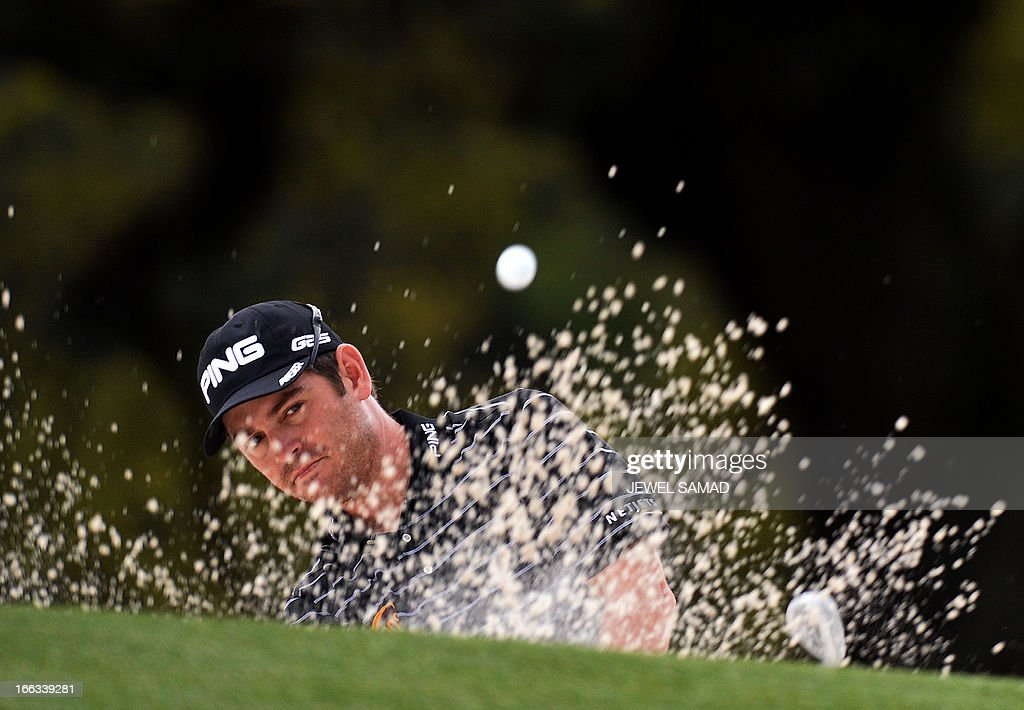 Louis Oosthuizen of South Africa hits out of the bunker on the 18th hole during the first round of the 2013 Masters Tournament at Augusta National Golf Club on April 11, 2013 in Augusta, Georgia. AFP PHOTO/Jewel Samad