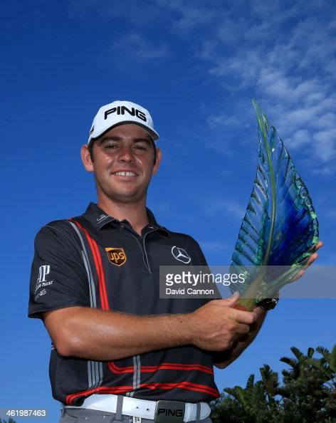 Louis Oosthuizen of South Africa holds the trophy after his victory during the final round of the 2014 Volvo Golf Champions at Durban Country Club on...