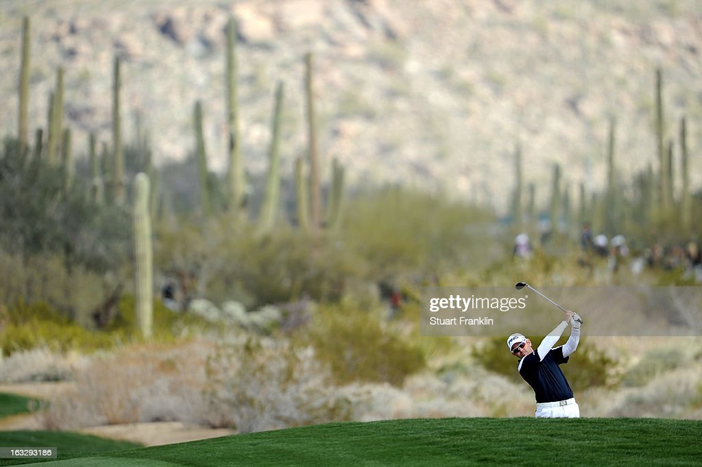 Louis Oosthuizen of South Africa in action during the first round of the World Golf Championships - Accenture Match Play at the Golf Club at Dove Mountain on February 21, 2013 in Marana, Arizona. Round one play was suspended on February 20 due to inclimate weather and is scheduled to be continued today.