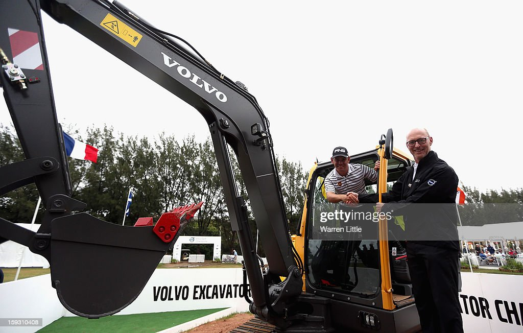 Louis Oosthuizen of South Africa is presented with his prize by Torbjorn Christensson, President, Volvo Southern Africa poses after winning the Amateur-Pro competition in the second round of the Volvo Golf Champions at Durban Country Club on January 11, 2013 in Durban, South Africa.