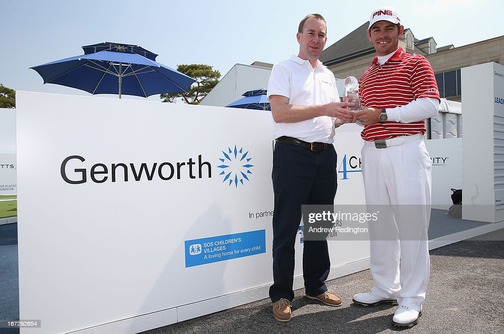 Louis Oosthuizen of South Africa (right) is presented with the 2012 Genworth Performance Award by Kevin Fleming, Vice President Genworth New Markets, during the Pro Am tournament prior to the start of the Ballantine's Championship at Blackstone Golf Club on April 24, 2013 in Icheon, South Korea.