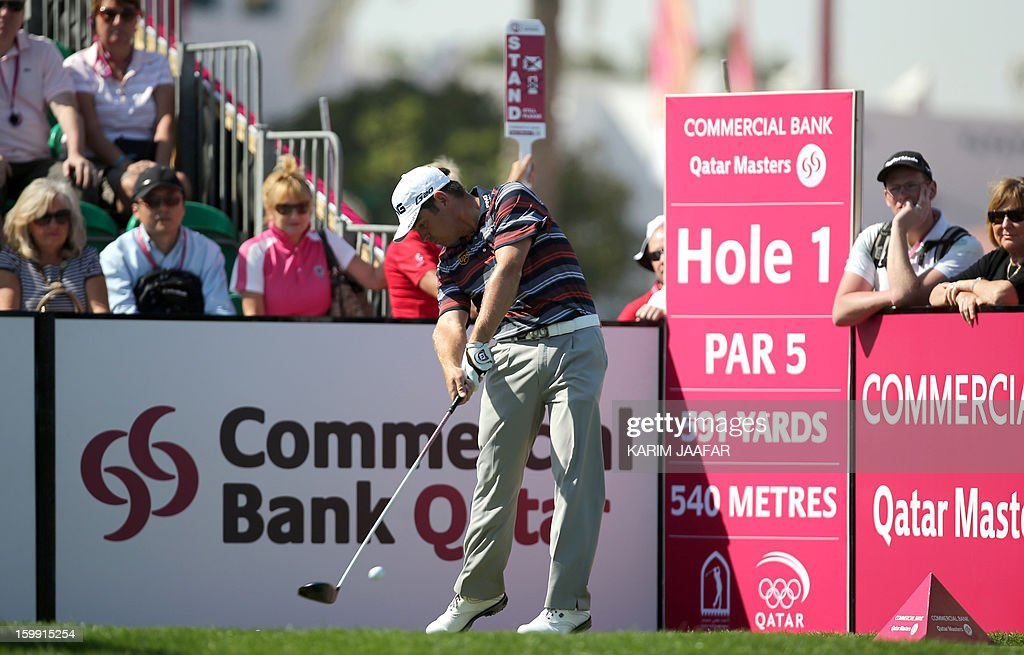 Louis Oosthuizen of South Africa is seen in action during the first round of the Qatar Masters Golf tournament in the Qatari capital Doha, on January 23, 2013. AFP PHOTO / AL-WATAN DOHA / KARIM JAAFAR == QATAR OUT ==