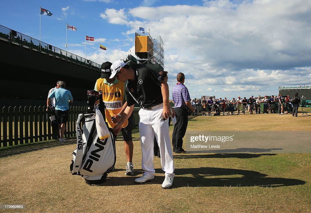 Louis Oosthuizen of South Africa leaves the course after withdrawing with an injury during the first round of the 142nd Open Championship at Muirfield on July 18, 2013 in Gullane, Scotland.
