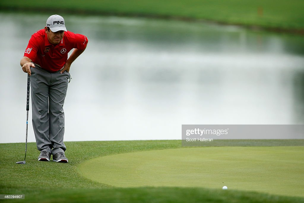 Louis Oosthuizen of South Africa looks at his ball on the green of the third hole during round one of the Shell Houston Open at the Golf Club of Houston on April 3, 2014 in Humble, Texas.