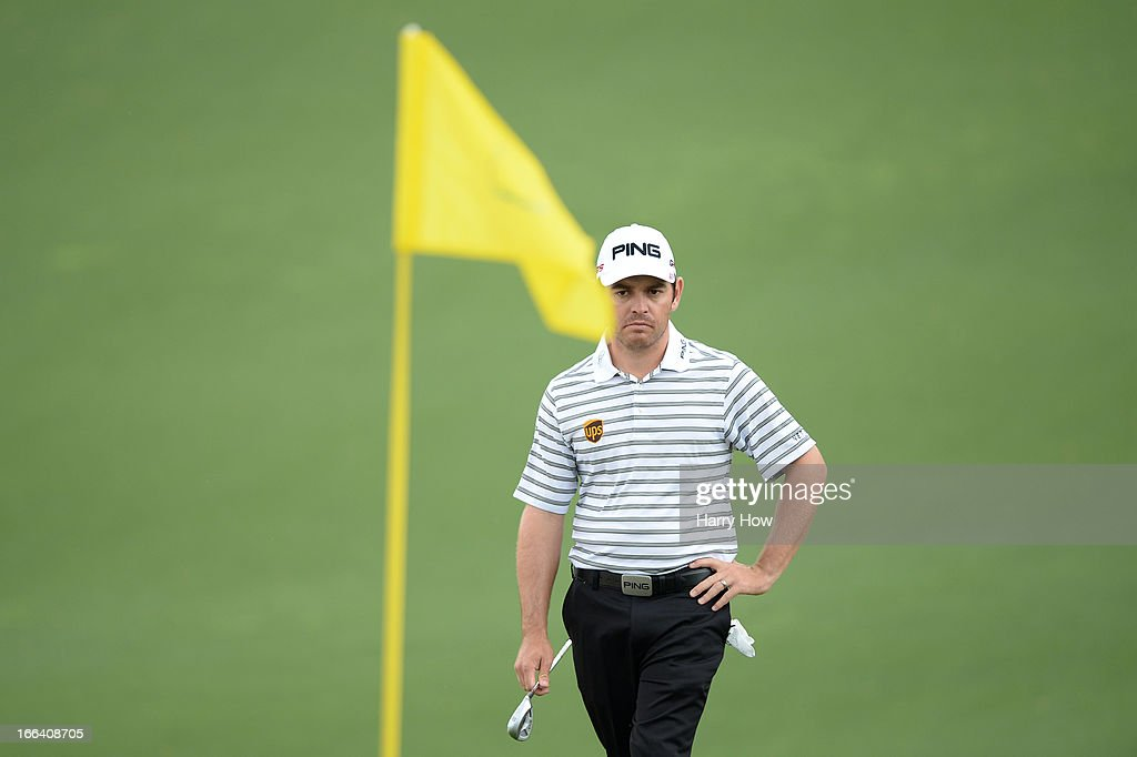 Louis Oosthuizen of South Africa looks on from the second hole during the second round of the 2013 Masters Tournament at Augusta National Golf Club on April 12, 2013 in Augusta, Georgia.