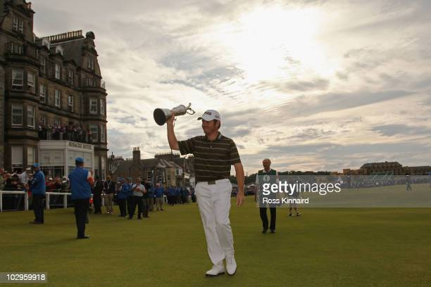 Louis Oosthuizen of South Africa parades the Claret Jug after his sevenstroke victory at the 139th Open Championship on the Old Course St Andrews on...