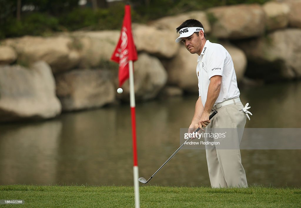 Louis Oosthuizen of South Africa plays a chip shot during the first round of the WGC - HSBC Champions at the Sheshan International Golf Club on October 31, 2013 in Shanghai, China.
