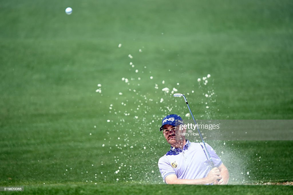 Louis Oosthuizen of South Africa plays a shot from a bunker on the second hole during the second round of the 2016 Masters Tournament at Augusta...