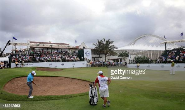 Louis Oosthuizen of South Africa plays his second shot at the par 4 18th hole during the first round of the 2014 Volvo Golf Champions at Durban...