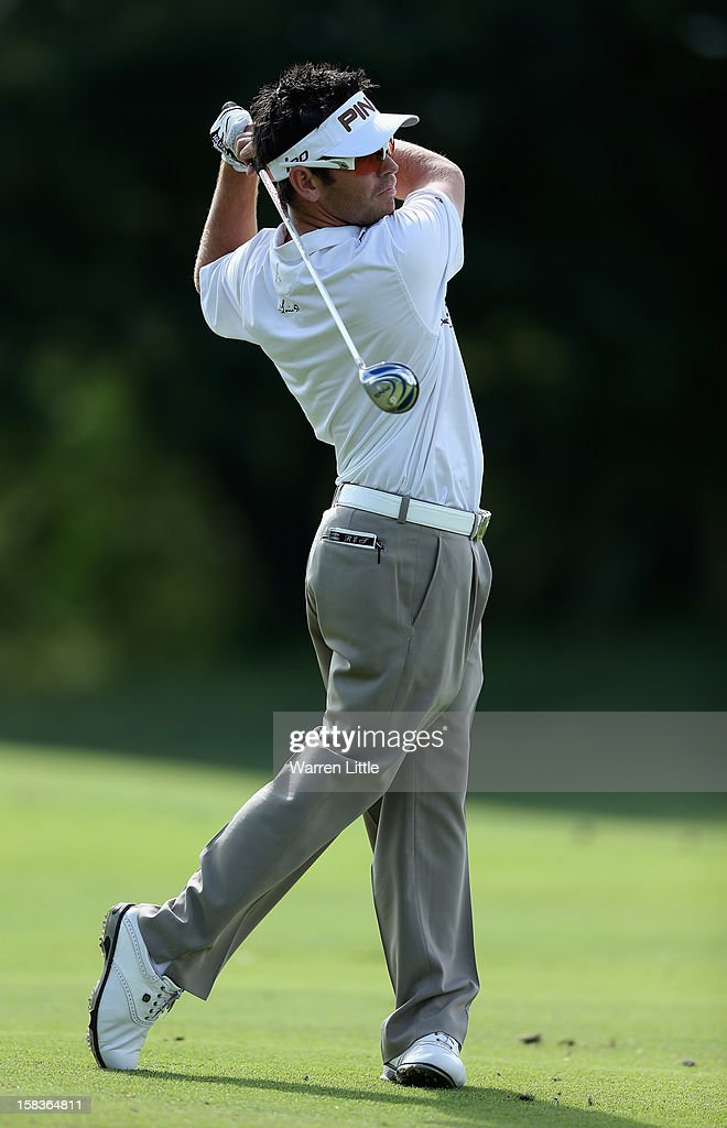 Louis Oosthuizen of South Africa plays his second shot into the 13th green during the second round of the Alfred Dunhill Championship at Leopard Creek Country Golf Club on December 14, 2012 in Malelane, South Africa.