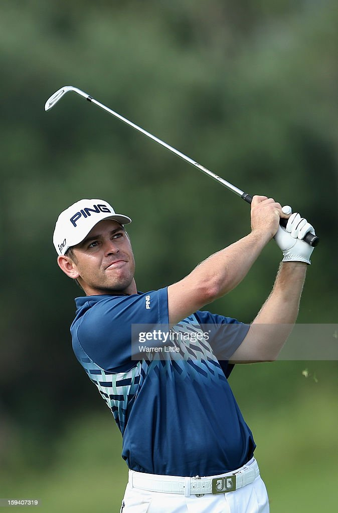 Louis Oosthuizen of South Africa plays his second shot into the 14th green during the final round of the Volvo Golf Champions at Durban Country Club on January 13, 2013 in Durban, South Africa.