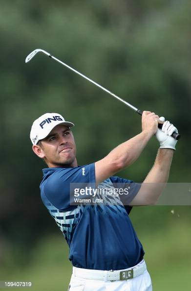 Louis Oosthuizen of South Africa plays his second shot into the 14th green during the final round of the Volvo Golf Champions at Durban Country Club...