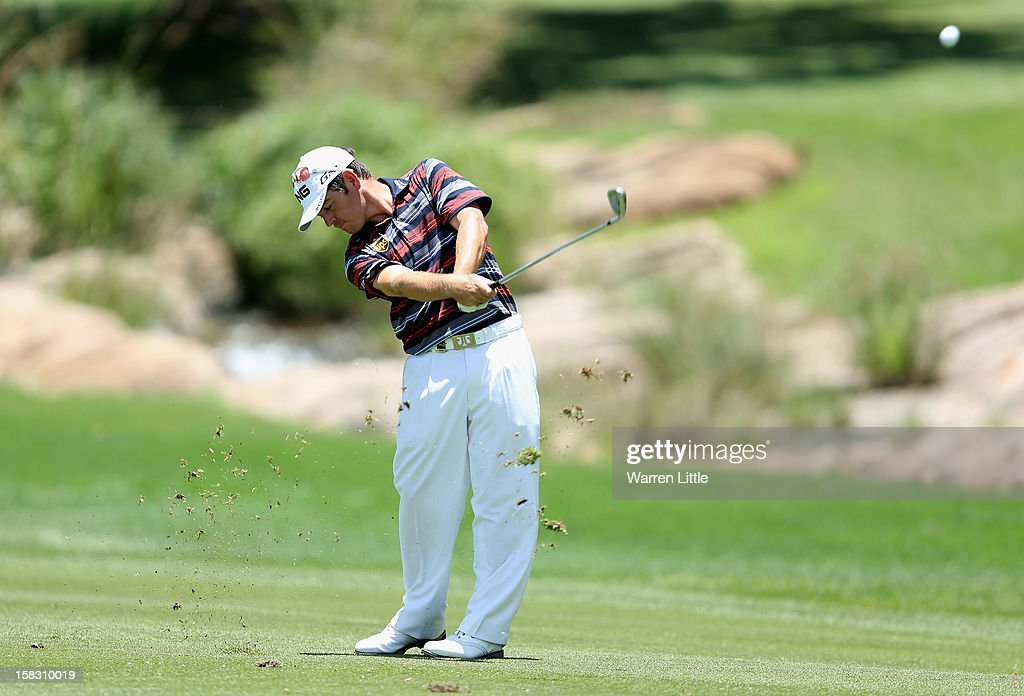 Louis Oosthuizen of South Africa plays his second shot into the 18th green during the first round of the Alfred Dunhill Championship at Leopard Creek Country Golf Club on December 13, 2012 in Malelane, South Africa.