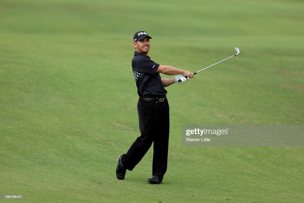 Louis Oosthuizen of South Africa plays his second shot into the first green during the Pro-Am for the Volvo Golf Champions at Durban Country Club on January 9, 2013 in Durban, South Africa.
