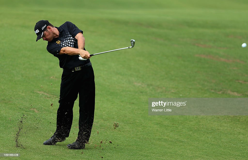 <a gi-track='captionPersonalityLinkClicked' href=/galleries/search?phrase=Louis+Oosthuizen&family=editorial&specificpeople=241573 ng-click='$event.stopPropagation()'>Louis Oosthuizen</a> of South Africa plays his second shot into the first green during the Pro-Am for the Volvo Golf Champions at Durban Country Club on January 9, 2013 in Durban, South Africa.