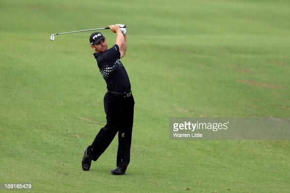 Louis Oosthuizen of South Africa plays his second shot into the first green during the ProAm for the Volvo Golf Champions at Durban Country Club on...