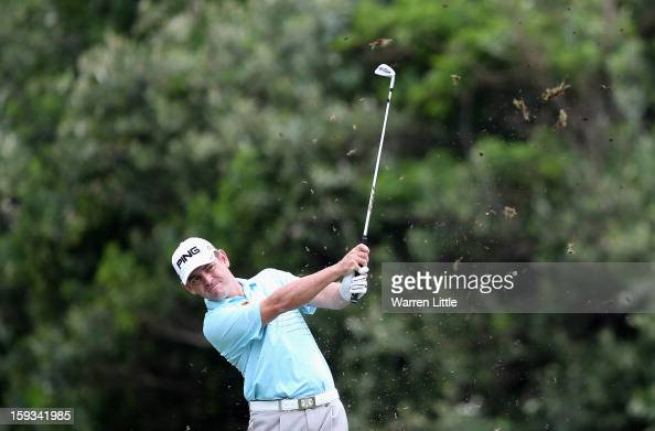 Louis Oosthuizen of South Africa plays his second shot into the first green during the third round of the Volvo Golf Champions at Durban Country Club...