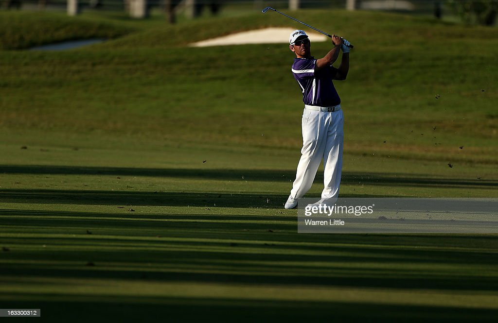 Louis Oosthuizen of South Africa plays his second shot on the 17th hole during the first round of the WGC-Cadillac Championship at the Trump Doral Golf Resort & Spa in Miami, Florida.