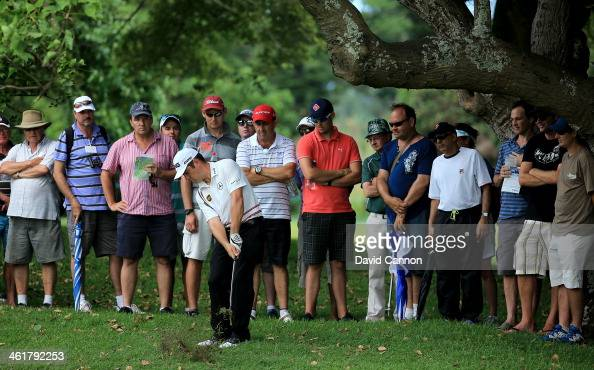Louis Oosthuizen of South Africa plays his second shot on the par 5 14th hole during the third round of the 2014 Volvo Golf Champions at Durban...