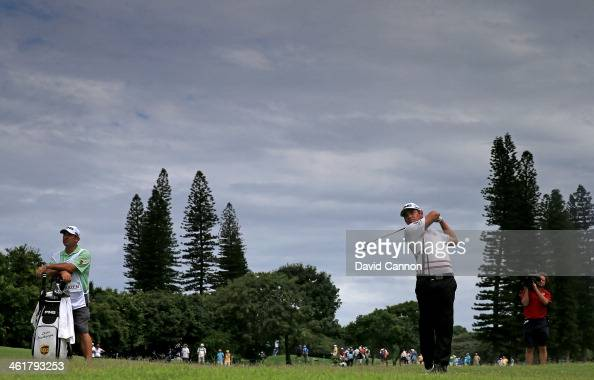 Louis Oosthuizen of South Africa plays his second shot on the par 5 10th hole during the third round of the 2014 Volvo Golf Champions at Durban...