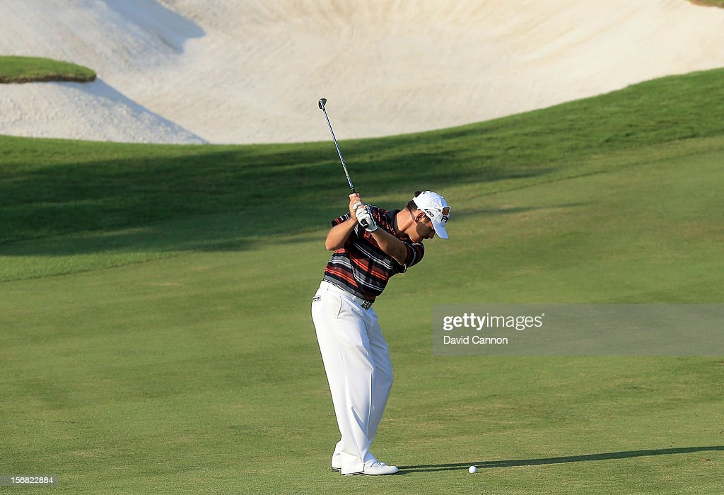 <a gi-track='captionPersonalityLinkClicked' href=/galleries/search?phrase=Louis+Oosthuizen&family=editorial&specificpeople=241573 ng-click='$event.stopPropagation()'>Louis Oosthuizen</a> of South Africa plays his second shot on the par four 15th hole during the first round of the 2012 DP World Tour Championship on the Earth Course at Jumeirah Golf Estates on November 22, 2012 in Dubai, United Arab Emirates.