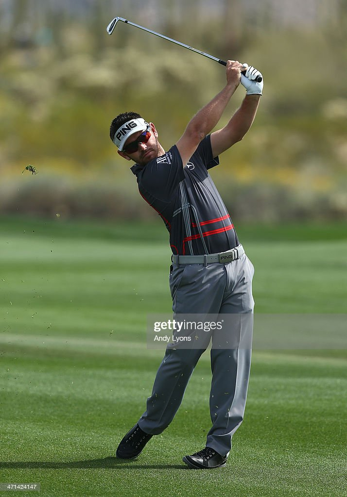 Louis Oosthuizen of South Africa plays his second shot on the second hole during the third round of the World Golf Championships - Accenture Match Play Championship at The Golf Club at Dove Mountain on February 21, 2014 in Marana, Arizona.