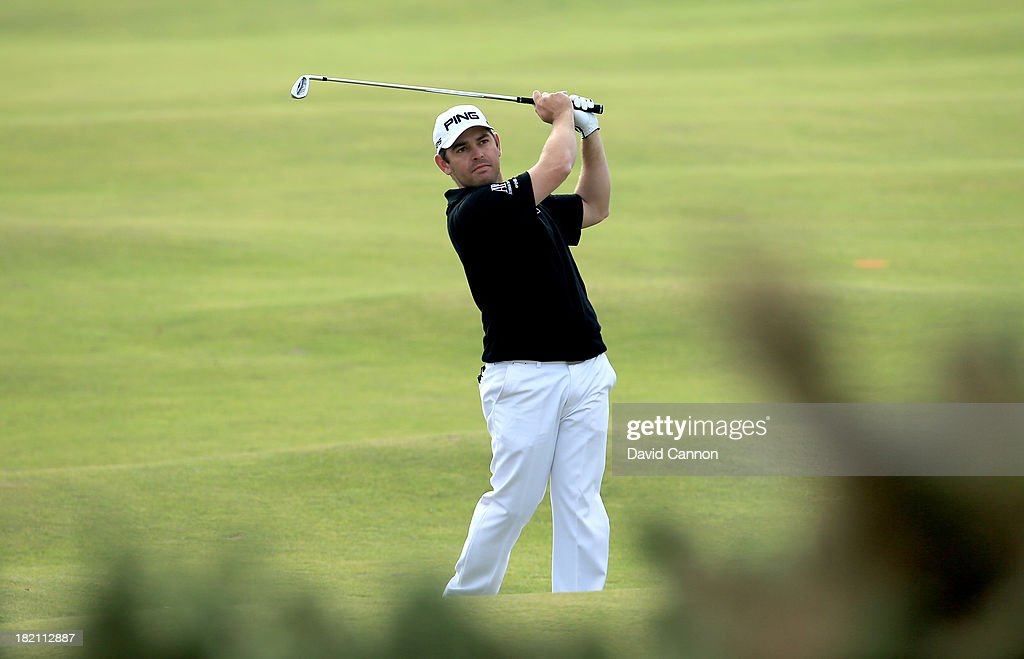 <a gi-track='captionPersonalityLinkClicked' href=/galleries/search?phrase=Louis+Oosthuizen&family=editorial&specificpeople=241573 ng-click='$event.stopPropagation()'>Louis Oosthuizen</a> of South Africa plays his second shot tot he fourth hole during the third round of the Alfred Dunhill Links Championship on The Old Course, at St Andrews on September 28, 2013 in St Andrews, Scotland.