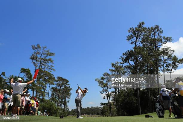 Louis Oosthuizen of South Africa plays his shot from the fourth tee during the final round of THE PLAYERS Championship at the Stadium course at TPC...