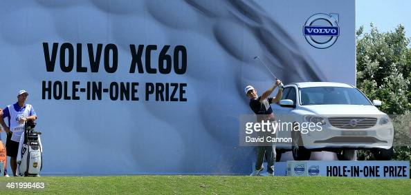 Louis Oosthuizen of South Africa plays his tee shot on the 12th hole during the final round of the 2014 Volvo Golf Champions at Durban Country Club...
