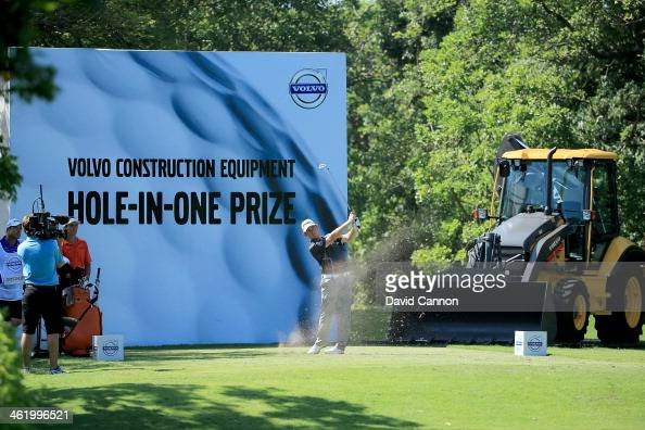 Louis Oosthuizen of South Africa plays his tee shot on the 15th hole during the final round of the 2014 Volvo Golf Champions at Durban Country Club...