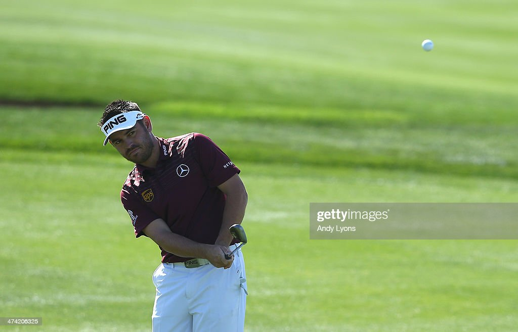 Louis Oosthuizen of South Africa plays his third shot on the fourth hole during the quarterfinal of the World Golf Championships - Accenture Match Play Championship at The Golf Club at Dove Mountain on February 22, 2014 in Marana, Arizona.
