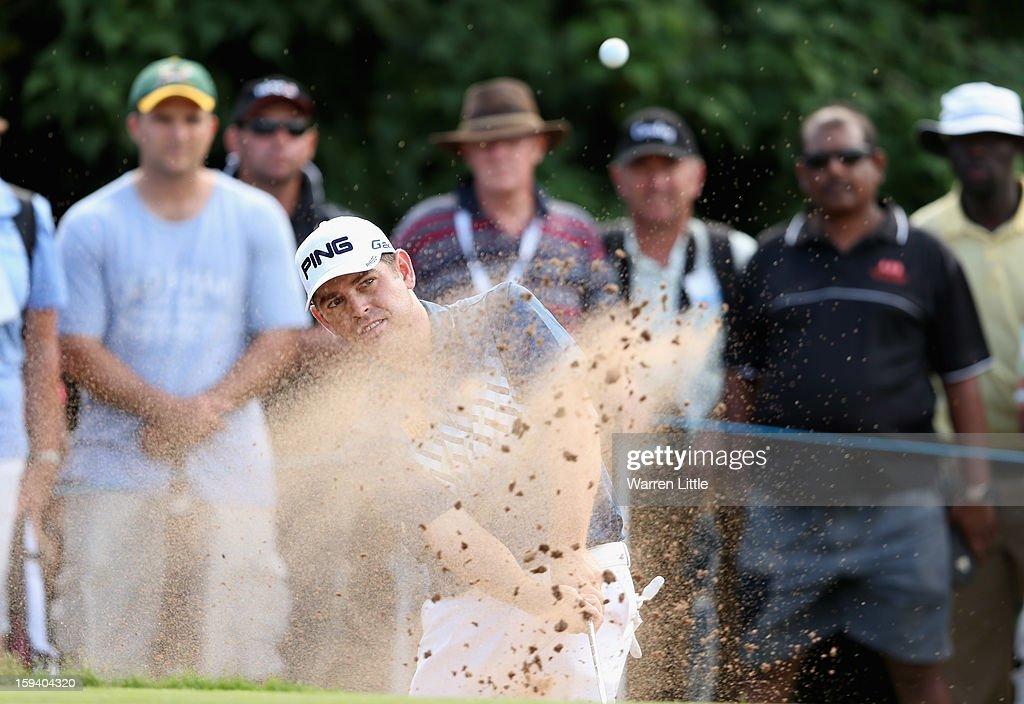 Louis Oosthuizen of South Africa plays out of the 14th greenside bunker during the final round of the Volvo Golf Champions at Durban Country Club on January 13, 2013 in Durban, South Africa.