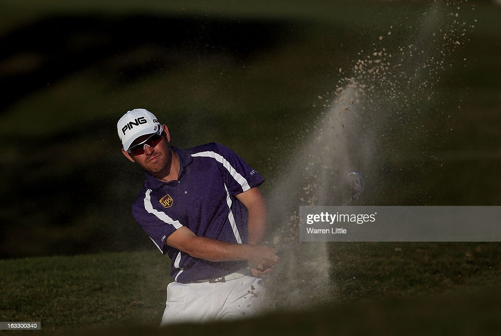 Louis Oosthuizen of South Africa plays out of the 16th greenside bunker during the first round of the WGC-Cadillac Championship at the Trump Doral Golf Resort & Spa in Miami, Florida.
