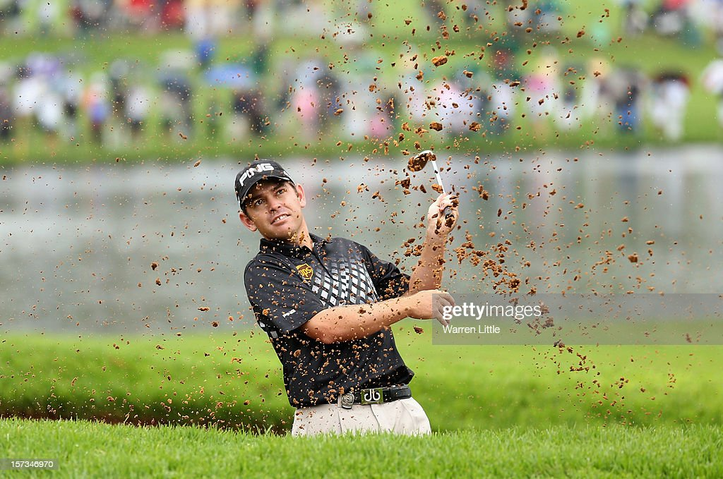 Louis Oosthuizen of South Africa plays out of the 18th greenside bunker during the final round of the Nedbank Golf Challenge at the Gary Player Country Club on December 2, 2012 in Sun City, South Africa.