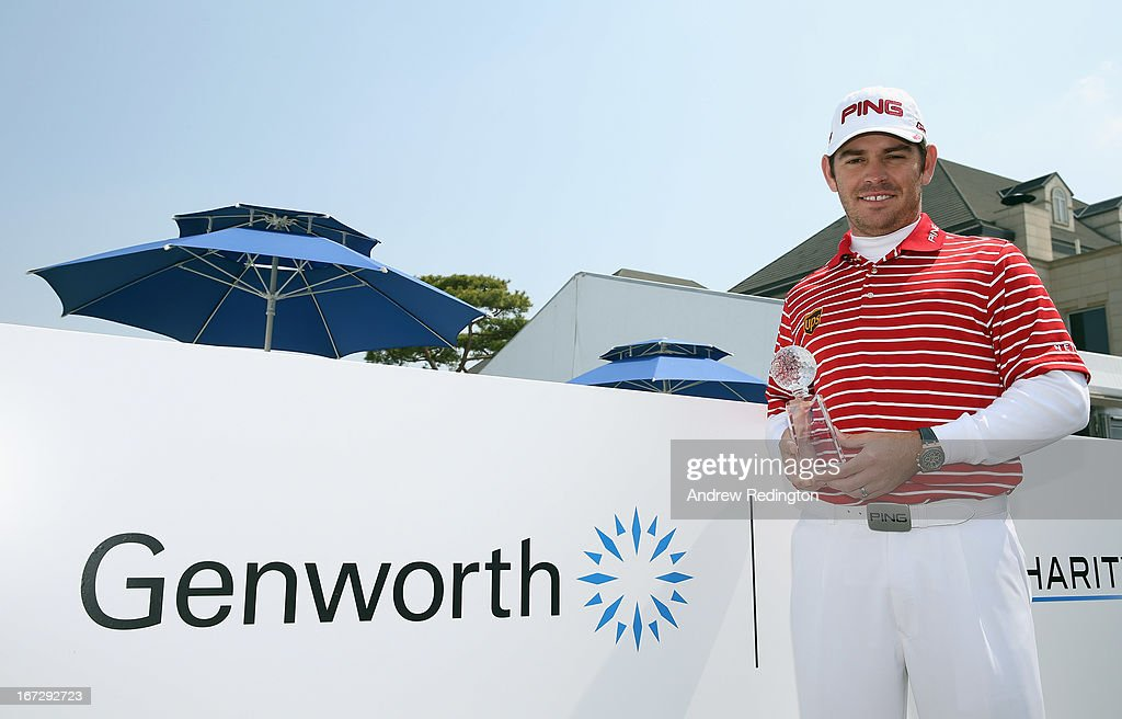 Louis Oosthuizen of South Africa poses with the 2012 Genworth Performance Award prior to the start of the Ballantine's Championship at Blackstone Golf Club on April 24, 2013 in Icheon, South Korea.