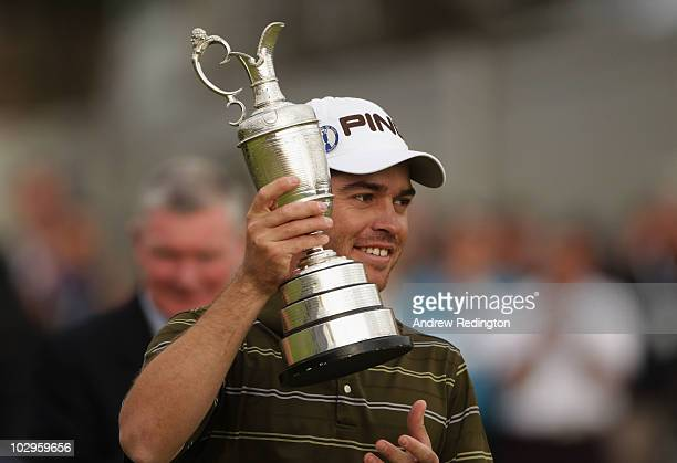 Louis Oosthuizen of South Africa poses with the Claret Jug after his sevenstroke victory at the 139th Open Championship on the Old Course St Andrews...