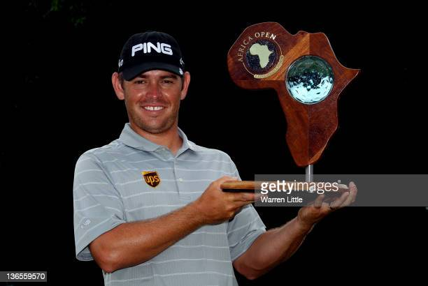 Louis Oosthuizen of South Africa poses with the trophy after winning the Africa Open on a score of 27 under par at East London GC on January 8 2012...