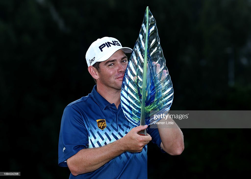 Louis Oosthuizen of South Africa poses with the trophy after winning the Volvo Golf Champions on a score of -16 under par at Durban Country Club on January 13, 2013 in Durban, South Africa.