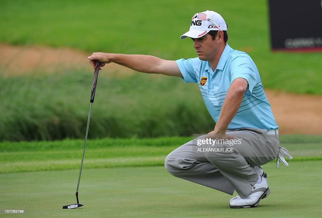Louis Oosthuizen of South Africa prepapes to play a shot on the 14th hole, on day 3 of the 4 day 2012 Nedbank Golf Challenge in Sun City on December 1, 2012. AFP PHOTO / Alexander Joe