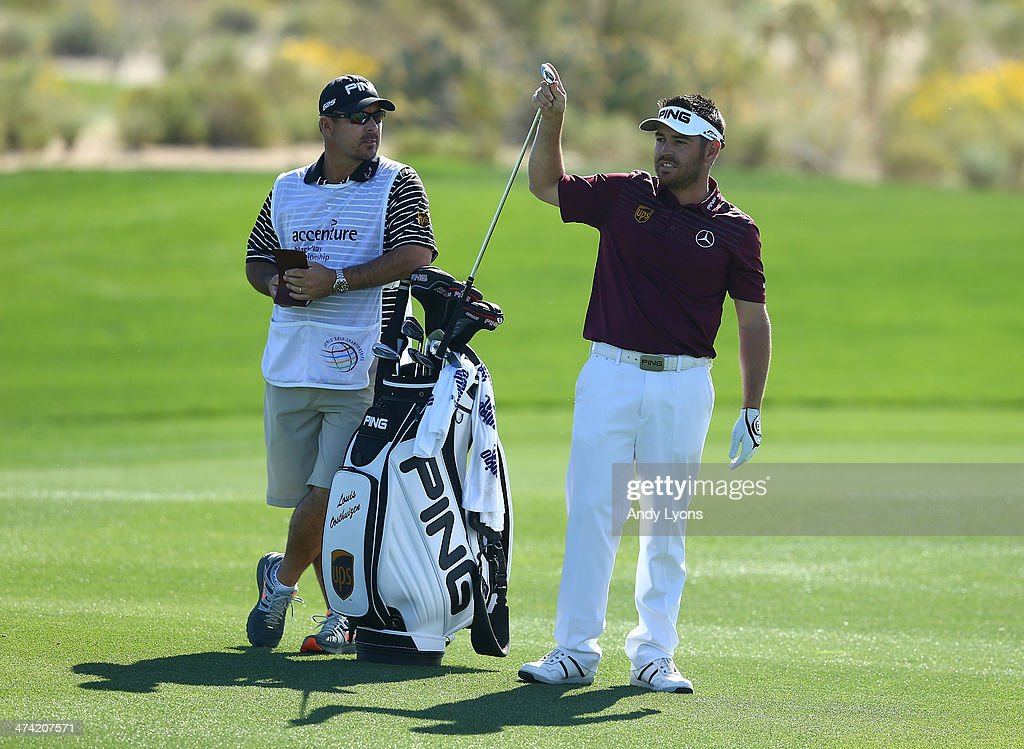Louis Oosthuizen of South Africa pulls a club out of his bag for his second shot on the fourth hole during the quarterfinal of the World Golf Championships - Accenture Match Play Championship at The Golf Club at Dove Mountain on February 22, 2014 in Marana, Arizona.