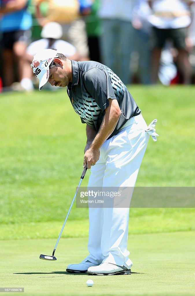 Louis Oosthuizen of South Africa putts on the third green during the first round of the Nedbank Golf Challenge at the Gary Player Country Club on November 29, 2012 in Sun City, South Africa.