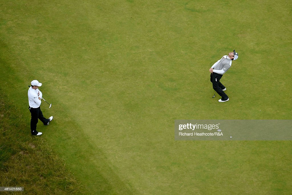 Louis Oosthuizen of South Africa (r) reacts after missing a par putt on the 17th hole as Zach Johnson of the United States looks on during the play off of the 144th Open Championship at The Old Course on July 20, 2015 in St Andrews, Scotland.