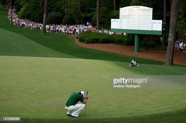 Louis Oosthuizen of South Africa reacts after missing a putt on the second sudden death playoff hole on the 10th during the final round of the 2012...